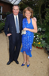 The DUKE & DUCHESS OF RUTLAND at the annual Cartier Flower Show Diner held at The Physics Garden, Chelsea, London on 23rd May 2005.<br /><br />NON EXCLUSIVE - WORLD RIGHTS