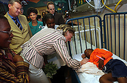 PRETORIA, SOUTH AFRICA - APRIL-26-2004 -.Princess Astrid of Belgium says hello to Emily Mabena, 5, as she and Marc Verwilghen , Belgian Minister of Development and Cooperation visit the childrens ward at the Pretoria Academic Hospital.Before the visit, Minister Verwilghen signed a bilateral agreement donating 3.5 million Euros of aid over the next four years to South Africa. (PHOTO © JOCK FISTICK)..<br />