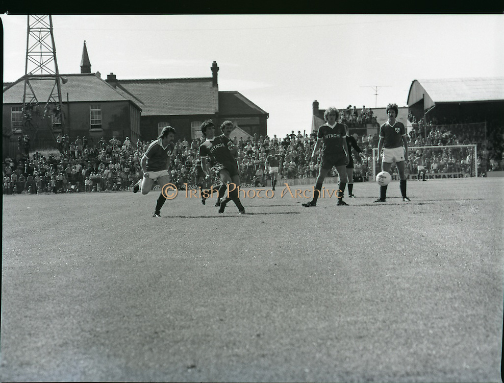 League of Ireland vs Liverpool FC.    (M87)..1979..18.08.1979..08.18.1979..18th August !979..In a pre season friendly the League of Ireland took on Liverpool FC at Dalymount Park Phibsborough,Dublin. The league team was made up of a selection of players from several League of Ireland clubs and was captained by the legendary John Giles. Liverpool won the game by 2 goals to nil..The scorers were Hansen and McDermott...Alan Hansen is pictured passing the ball back to his keeper to break up an Irish attack.
