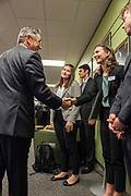 Dave Scholl, Board of Trustees chair, shakes hands with Winter Wilson, a university innovation fellow and a junior in environmental studies and journalism, at the grand opening and ribbon cutting for the new CoLab, Ohio University's hub of innovation and entrepreneurial activities, on the third floor of the Vernon Alden Library, October 18, 2018. (Photo by Stephen Zenner/Ohio University Libraries)