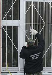 61009843<br /> Investigative Committee officer at a school in northeast Moscow, where a high-school student took fellow pupils hostage and shot a teacher and a police officer dead. The teenager has been detained, Moscow, Russia, Monday, 3rd February 2014. Picture by  imago / i-Images<br /> UK ONLY