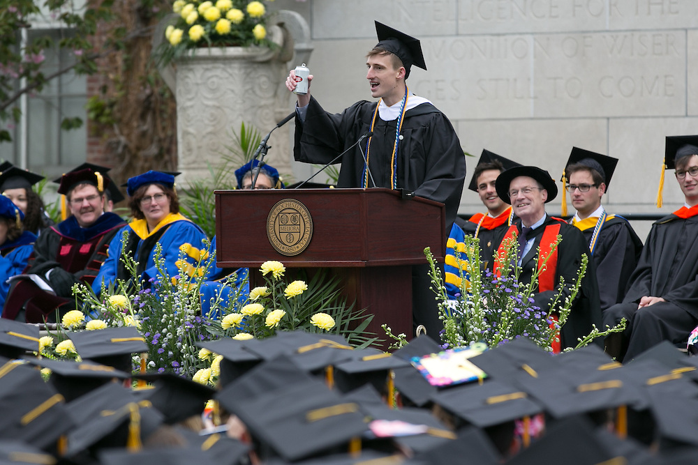 Ulrik Soderstrom, President of the Senior Class Council, raises a can of Genesee beer at the University of Rochester's Commencement ceremony in Rochester on Sunday, May 15, 2016.