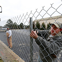 Thomas Wells | BUY AT PHOTOS.DJOURNAL.COM<br /> Levi Burcham of Ivy Fence Company begins securing a fence around the the empty Travel Lodge Hotel on North Gloster on Tuesday.