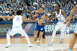 Kentucky guard Isaiah Briscoe is stripped as he drives to the basket in the first half. <br /> <br /> The University of Kentucky hosted the University of North Carolina in a 2017 NCAA D1 Men's South Regional Championship, Sunday, March 26, 2017 at FedExForum in Memphis.