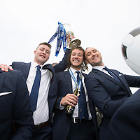 St Johnstone v Dundee United....18.05.14   William Hill Scottish Cup Final<br /> Tom Scobbie, Stevie May and Lee Croft with the Scottish Cup on the open top bus parade<br /> Picture by Graeme Hart.<br /> Copyright Perthshire Picture Agency<br /> Tel: 01738 623350  Mobile: 07990 594431
