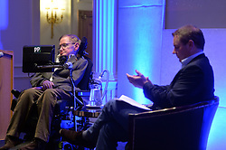 Professor Stephen Hawking reveals the findings of 'A Brief History of How England Can Win The World Cup' a study commissioned by Paddy Power at The Savoy, London, UK.<br /> <br /> Pictures is Paddy Power (right), interviewing Professor Stephen Hawking.<br /> <br /> Wednesday, 28th May 2014. Picture by Ben Stevens / i-Images