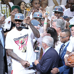 Jun 21, 2012; Miami, FL, USA; NBA commissioner David Stern presents the MVP trophy to Miami Heat small forward LeBron James after winning the 2012 NBA championship at the American Airlines Arena. Miami won 121-106. Mandatory Credit: Derick E. Hingle-US PRESSWIRE