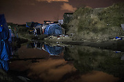 Feb. 23, 2016 - Calais, France - <br /> <br /> In front of the temporary shelter, tents are abandoned and are flooded by water. In Calais, northern France, February 23, 2016<br /> ©Exclusivepix Media