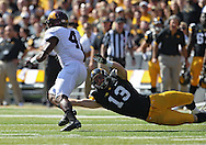September 29 2012: Iowa Hawkeyes linebacker Tom Donatell (13) tries to grab Minnesota Golden Gophers running back KJ Maye during the first quarter of the NCAA football game between the Minnesota Golden Gophers and the Iowa Hawkeyes at Kinnick Stadium in Iowa City, Iowa on Saturday September 29, 2012. Iowa defeated Minnesota 31-13 to claim the Floyd of Rosedale Trophy.