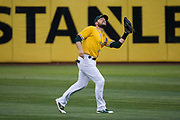 Oakland Athletics second baseman Jed Lowrie (8) catches a pop fly against the Los Angeles Angels at Oakland Coliseum in Oakland, California, on September 5, 2017. (Stan Olszewski/Special to S.F. Examiner)