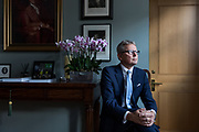 London, England, UK, October 2 2018 - Portrait of Jussi Pylkkännen, global president and main auctioneer of Christie's, in the meeting room next to his office.