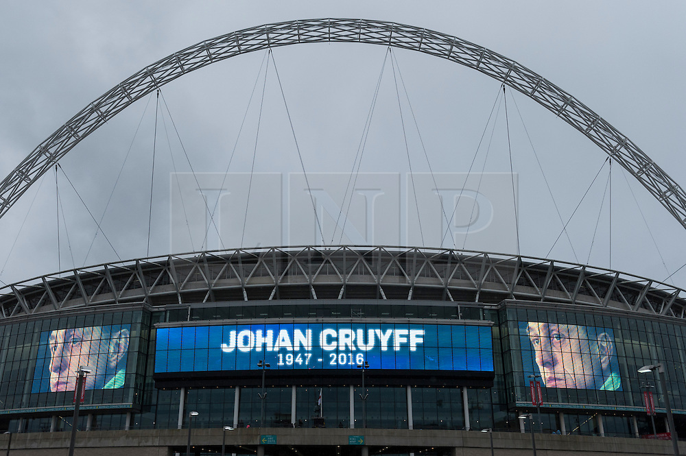 © Licensed to London News Pictures. 29/03/2016. London, UK. Ahead of the friendly match between England and the Netherlands, Wembley Stadium pays tribute to the Dutch football legend, Johan Cruyff, who passed away from cancer recently. Photo credit : Stephen Chung/LNP