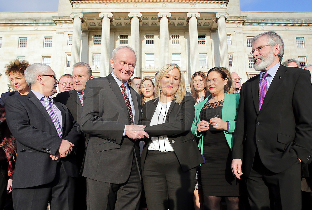 © Licensed to London News Pictures. STORMONT BELFAST - 23 JAN 2017: Sinn Fein's Michelle O'Neill (centre) shakes hands with Martin McGuinness, while stood next to Gerry Adams (right), on the steps of Stormont after being named as the new leader of Sinn Fein in the North, taking over from former deputy first minister Martin McGuinness who has retired due to illness. Photo credit: London News Pictures.