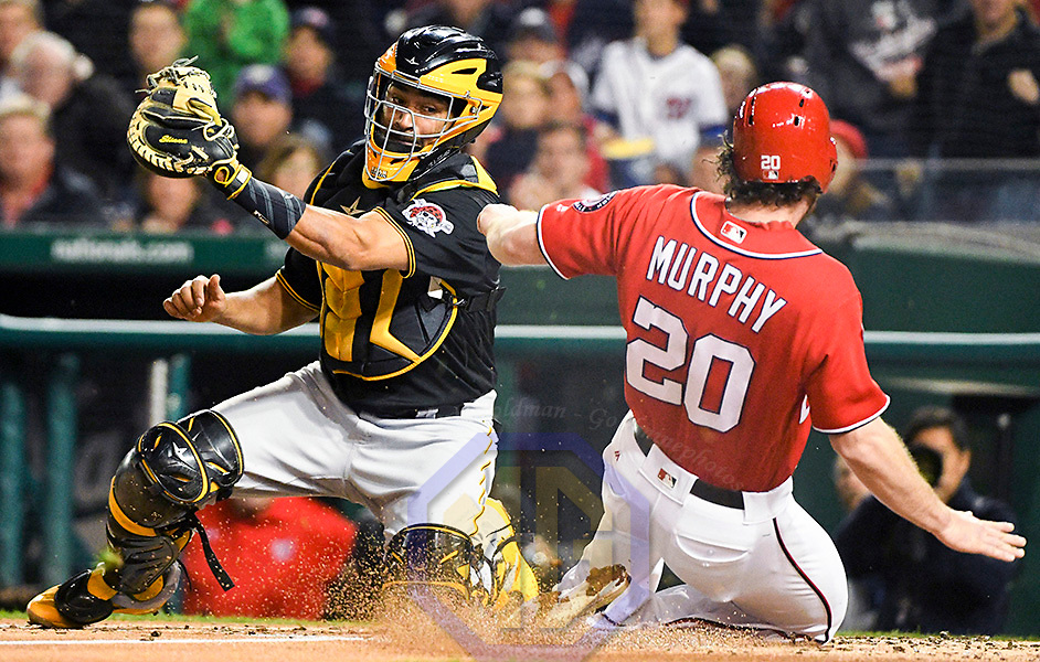 WASHINGTON, DC - SEPTEMBER 30: Washington Nationals second baseman Daniel Murphy (20) scores in the second inning as Pittsburgh Pirates catcher Elias Diaz (32) takes the throw during an MLB game between the Pittsburgh Pirates and the Washington Nationals on September 30, 2017, at Nationals Park in Washington, D.C.  (Photo by Mark Goldman/Icon Sportswire)
