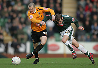 Photo: Lee Earle.<br /> Plymouth Argyle v Hull City. FA Cup Third Round. 05/01/2008. <br /> Hull's Dean Marney (L) battles with Luke Summerfield.