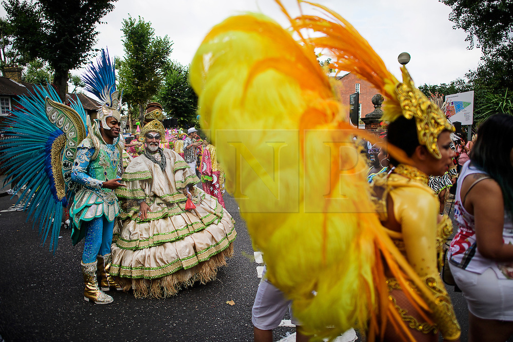 © Licensed to London News Pictures. 29/08/2016. London, UK. Carnival goers prepare to enjoy day two of the Notting Hill carnival, the second largest street festival in the world after the Rio Carnival in Brazil, attracting over 1 million people to the streets of West London.  Photo credit: Ben Cawthra/LNP