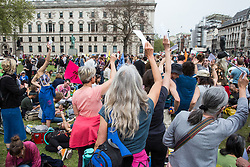 London, UK. 23rd April 2019. Climate change activists from Extinction Rebellion attending an assembly in Parliament Square hold up letters to their Members of Parliament requesting meetings to discuss the issue of climate change. Activists later tried to deliver their letters to Parliament, but all but ten were prevented from doing so by the Metropolitan Police.