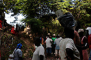 Every year, thousands of Haitians flock to Ville-Bonheur in Haiti for the July 16 feast of Our Lady of Mount Carmel. According to legend, the Virgin Mary showed herself in the mid-1800s on a tree near the waterfall. Every year since, Haitians make the pilgrimage to the waterfall to be blessed in the sacred water. July 2010 was no exception. Following the devastating earthquake that hit the country in January 2010, the prayers were many.