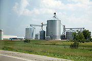 Grain elevators of Central Grain Inc. beside freeway 94. Sauk Centre Minnesota MN USA