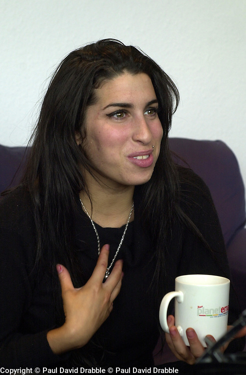 Amy Winehouse Interviewed by local media before she performs an Intimate concert at Sheffields Hallam FM Local Radio Station..14 October 2004.This Images is Copyright Paul David Drabble