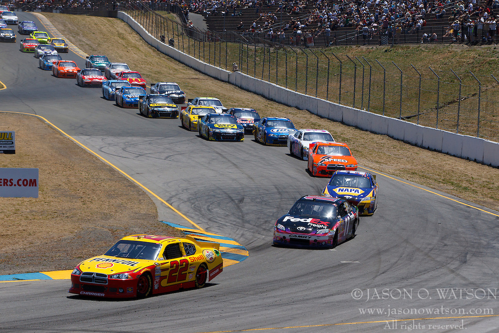 June 26, 2011; Sonoma, CA, USA;  NASCAR Sprint Cup Series driver Kurt Busch (22) leads the field after a restart during the Toyota/Save Mart 350 at Infineon Raceway.