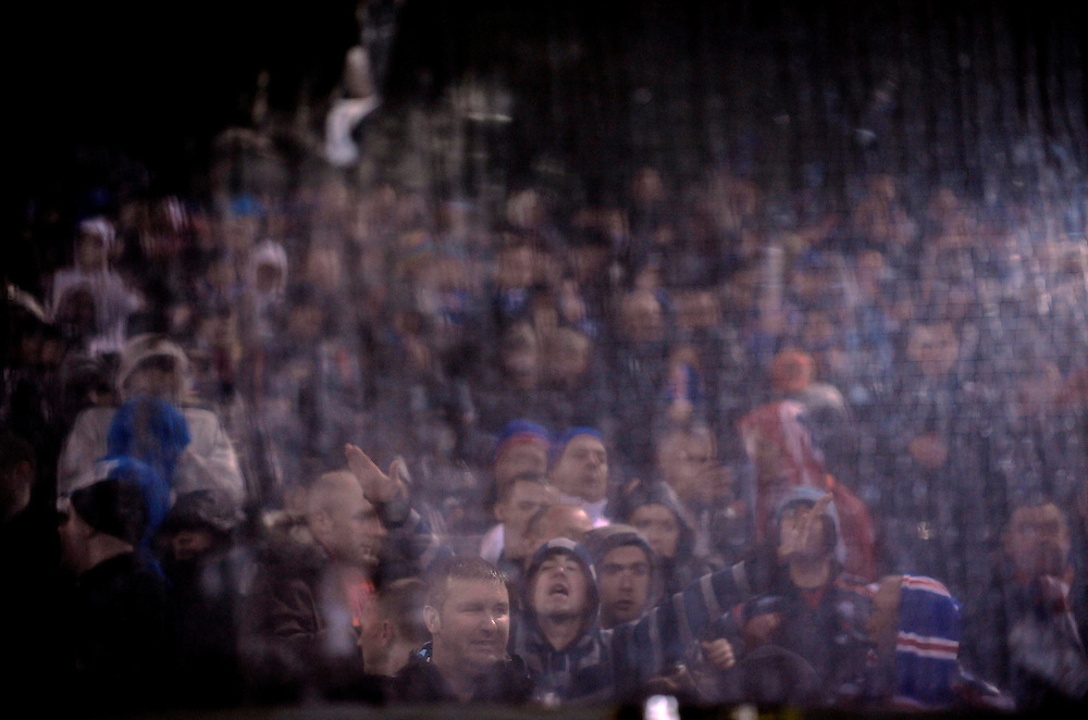 Rangers fans are seen through the plastic protection glass, during their match against Unirea Urziceni, in the Champions League group G.