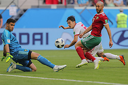 June 15, 2018 - Saint Petersburg, Russia - Sardar Azmoun (C) of the Iran national football team and Noureddine Amrabat (R) of the Morocco national football team vie for the ball during the 2018 FIFA World Cup match, first stage - Group B between Morocco and Iran at Saint Petersburg Stadium on June 15, 2018 in St. Petersburg, Russia. (Credit Image: © Igor Russak/NurPhoto via ZUMA Press)