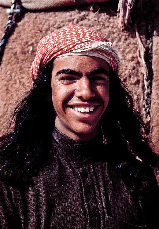 Young bedouin man competing in the annual camel race at Jinayderiah, near Riyadh, Saudi Arabia