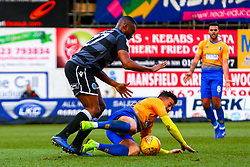 Tyler Walker of Mansfield Town is brought down by Nathan Cameron of Macclesfield Town - Mandatory by-line: Ryan Crockett/JMP - 02/02/2019 - FOOTBALL - One Call Stadium - Mansfield, England - Mansfield Town v Macclesfield Town - Sky Bet League Two