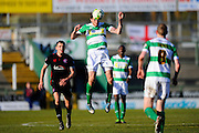 Yeovil Town's Ben Tozer heads the ball during the Sky Bet League 2 match between Yeovil Town and Carlisle United at Huish Park, Yeovil, England on 25 March 2016. Photo by Graham Hunt.
