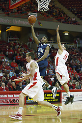 03 December 2011:  Nic Moore gets caught behind a shooting Adam Smith during an NCAA mens basketball game where the University of North Carolina at Wilmington Seahawks defeated the Illinois State Redbirds 63-54 inside Redbird Arena, Normal IL