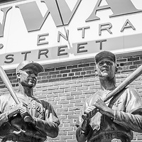 Boston Fenway Park Gate B entrance sign and four bronze statues of Ted Williams, Johnny Pesky, Bobby Doerr and Dom DiMaggio black and white photo. Fenway Park is home to the Boston Red Sox MLB baseball team in the Eastern United States.