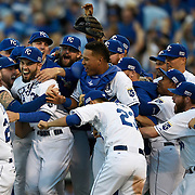 The Kansas City Royals team celebrates after winning Game 4 of the American League Championship Series playoff baseball game on Wednesday October 15, 2014 at Kauffman Stadium in Kansas City, MO. The Royals beat the Baltimore Orioles 2-1 to advance to the World Series.