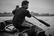 2015-12-23. A treasure hunter on his boat near the Phra Chan Pier on the Chaophraya River.