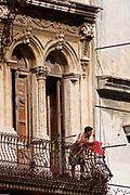 Relaxing on the balcony, Havana
