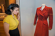 Jennifer Siggs, of the IWM with CC41 utility wear - Fashion on the Ration: 1940s Street Style – a new exhibition at the Imperial War Museum to mark the 70th anniversary of the end of the Second World War in 1945.  Divided into six sections:  Into Uniform looks at how Second World War Britain became a nation in uniform;  Functional Fashion explores how the demands of wartime life changed the way civilians dressed at work and at home;  Rationing and Make do and Mend will look at why clothes rationing was introduced in 1941, how the scheme worked and how it changed the shopping habits of the nation, including a bridesmaid's dress made from parachute material, a bracelet made from aircraft components, a child's coat made from a blanket and on display for the first time a bra and knickers set made from RAF silk maps for Countess Mountbatten;  Utility Clothing was introduced in 1941 to tackle unfairness in the rationing scheme and standardise production to help the war effort; Beauty as Duty examines the lengths to which many women went, to maintain their personal appearance – and the pressure they felt to do so; and Peace and a new look? which looks at how the end of the war impacted upon fashion, and considers the long-term impact, including a 'VE' print dress worn by the comedienne Jenny Hayes to celebrate the end of the war, and an example of the ubiquitous demob-suit, issued to men leaving the military services. The exhibition runs from 5 March – 31 August 2015