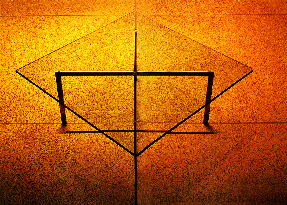 Glass table designed by Mies van der Rohe on marble floor in Seagram Building. Photographed for Mies/Knoll brochure in 1968. Taken with a 35 mm Nikon FM.