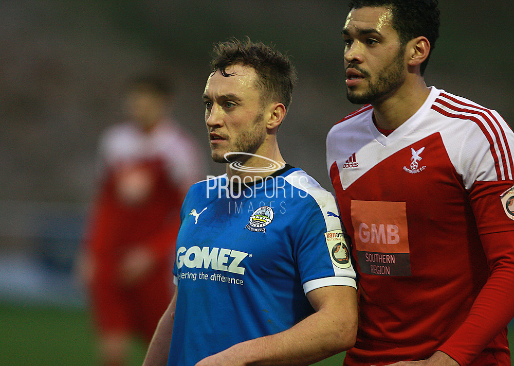 Whitehawk defender Jordan Rose keeps tight to Dover striker Ricky Miller during the FA Trophy match between Whitehawk FC and Dover Athletic at the Enclosed Ground, Whitehawk, United Kingdom on 12 December 2015. Photo by Bennett Dean.