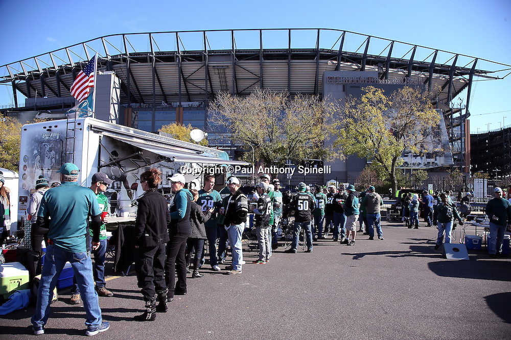 Philadelphia Eagles fans tailgate in this wide angle photograph of Lincoln Financial Field taken from the parking lot before the Philadelphia Eagles 2015 week 10 regular season NFL football game against the Miami Dolphins on Sunday, Nov. 15, 2015 in Philadelphia. (©Paul Anthony Spinelli)