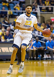 Dec 17, 2016; Morgantown, WV, USA; West Virginia Mountaineers forward Esa Ahmad (23) dribbles the ball during the second half against the UMKC Kangaroos at WVU Coliseum. Mandatory Credit: Ben Queen-USA TODAY Sports