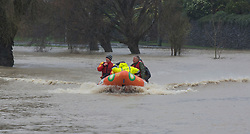 Emergency services check for stuck residents in St Martins after flooding from the Heathcote River, Christchurch, New Zealand, Saturday, July 22, 2017. Credit:  SNPA / David Alexander -NO ARCHIVING-