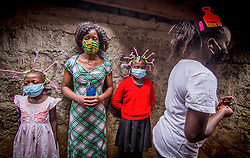 May 9, 2020, Nairobi, Kenya: Young Girls from Kibera Slums use their Corona Virus braided hair style in creating awareness during the corona virus pandemic..Kenya has recorded 649 confirmed cases, 207 recovered and 30 deaths to the covid 19 disease. (Credit Image: © Donwilson Odhiambo/SOPA Images via ZUMA Wire)