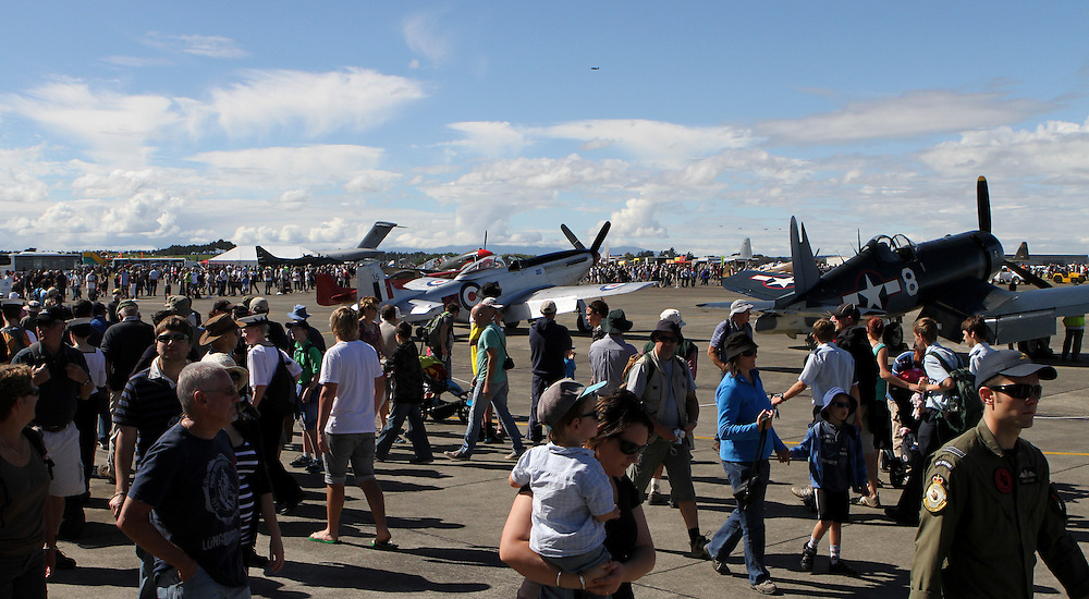 Crowds around the vintage aircraft display in the 75th Anniversary Airshow at Ohakea Airforce base, New Zealand, Saturday, 31 March, 2012. Credit:SNPA / John Cowpland