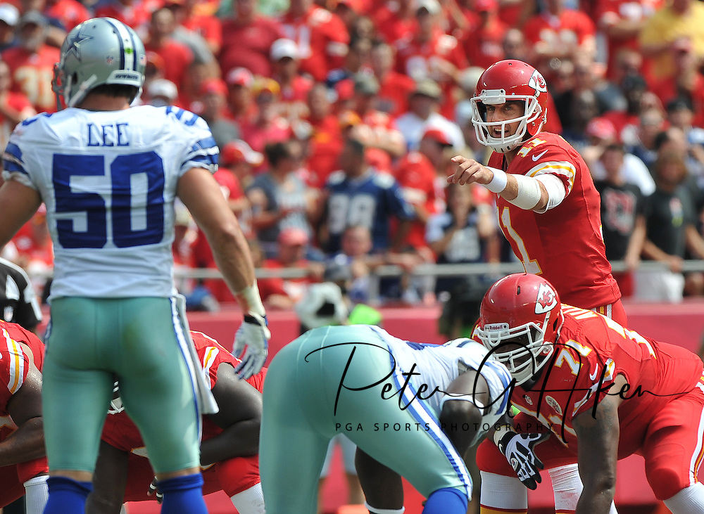 KANSAS CITY, MO - SEPTEMBER 15:  Quarterback Alex Smith #11 of the Kansas City Chiefs points out some instructions against the Dallas Cowboys during the first half on September 15, 2013 at Arrowhead Stadium in Kansas City, Missouri.  (Photo by Peter G. Aiken/Getty Images) *** Local Caption *** Alex Smith