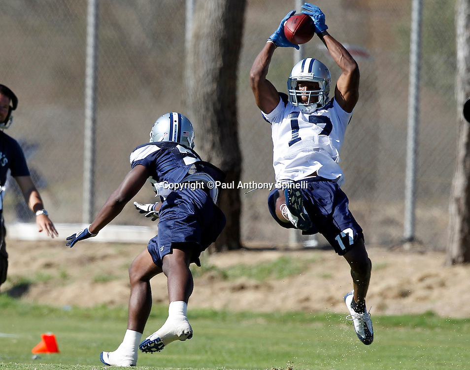 Dallas Cowboys wide receiver Sam Hurd (17) leaps to catch a touchdown pass while covered by rookie safety Akwasi Owusu-Ansah (27) during NFL football training camp on Wednesday, August 18, 2010 in Oxnard, California. (©Paul Anthony Spinelli)