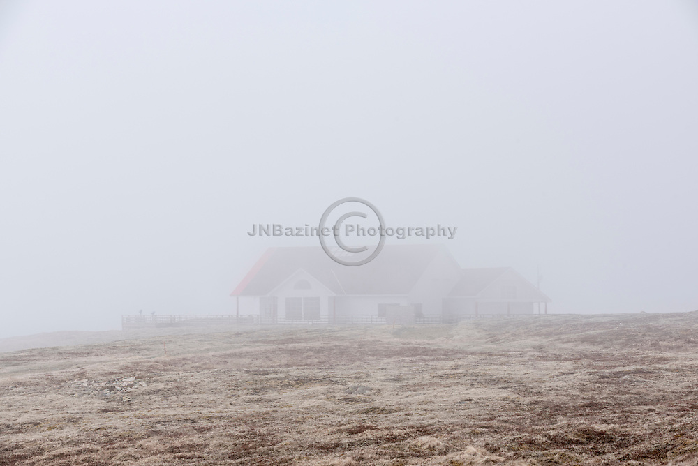 Rolling fog covers Cape St. Mary's Ecological Reserve tourist information centre.