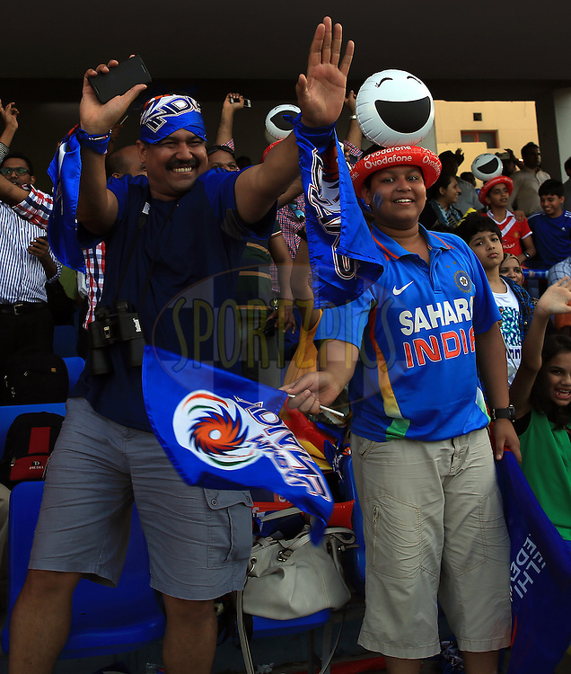 Mumbai Indians Fan's enjoys during match 16 of the Pepsi Indian Premier League 2014 between the Delhi Daredevils and the Mumbai Indians held at the Sharjah Cricket Stadium, Sharjah, United Arab Emirates on the 27th April 2014<br /> <br /> Photo by Sandeep Shetty / IPL / SPORTZPICS