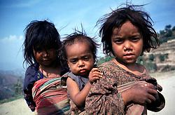 NEPAL KATHMANDU VALLEY APR95 - Three Nepalese village children pose for a photograph. <br /> <br /> jre/Photo by Jiri Rezac<br /> <br /> © Jiri Rezac 1995<br /> <br /> Tel: +44 (0) 7050 110 417<br /> Email: info@jirirezac.com<br /> Web: www.jirirezac.com