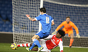 STEFAN O'CONNOR slide tackles Jesse Starkey during the Barclays U21 Premier League match between Brighton U21 and Arsenal U21 at the American Express Community Stadium, Brighton and Hove, England on 1 December 2014.