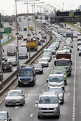 © Licensed to London News Pictures. 28/08/2015. London, UK. Heavy traffic jams and grid lock traffic leaving London for the August bank holiday Friday on the A13 near Beckton in east London. Photo credit : Vickie Flores/LNP